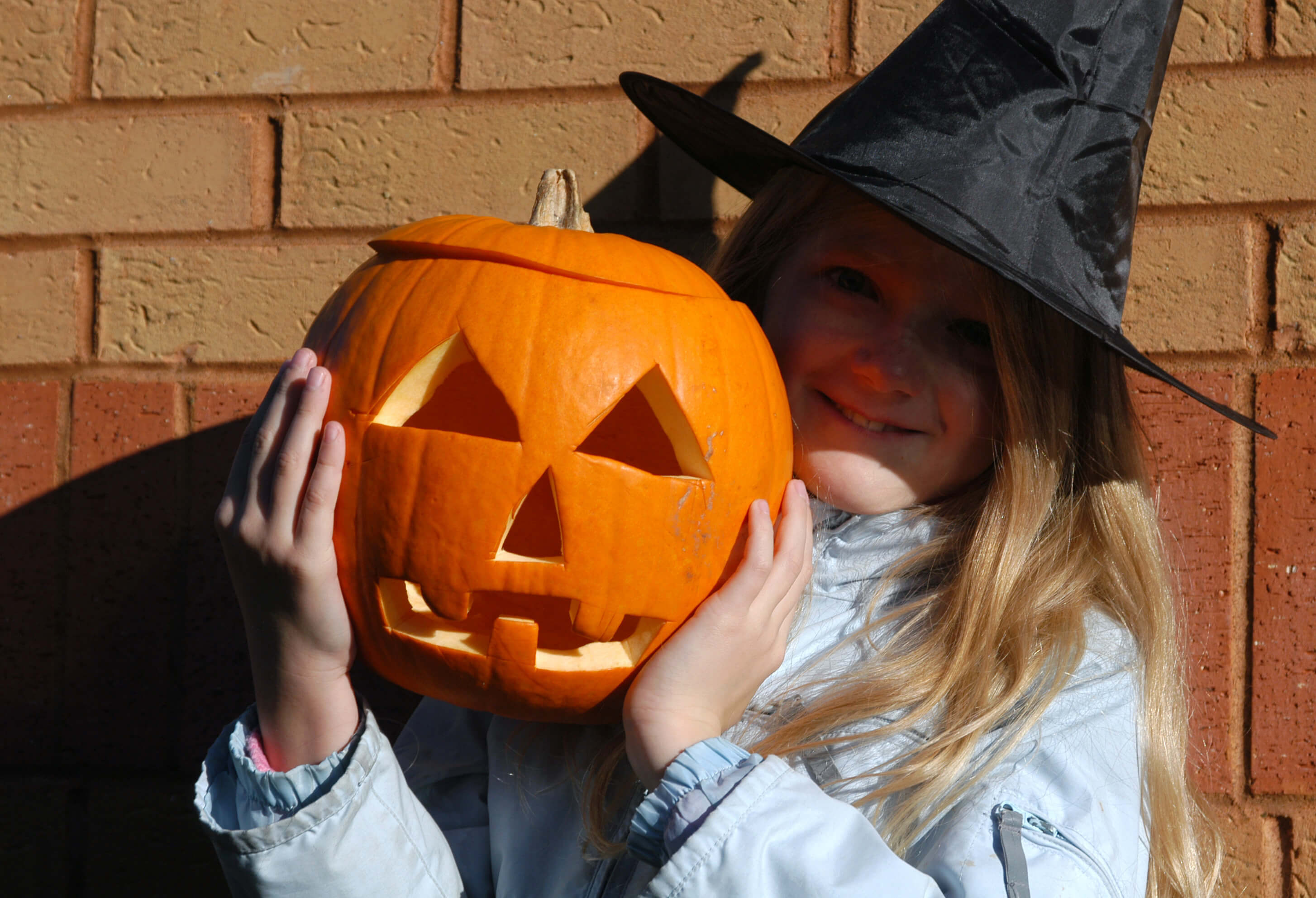 Young girl with a Halloween pumpkin