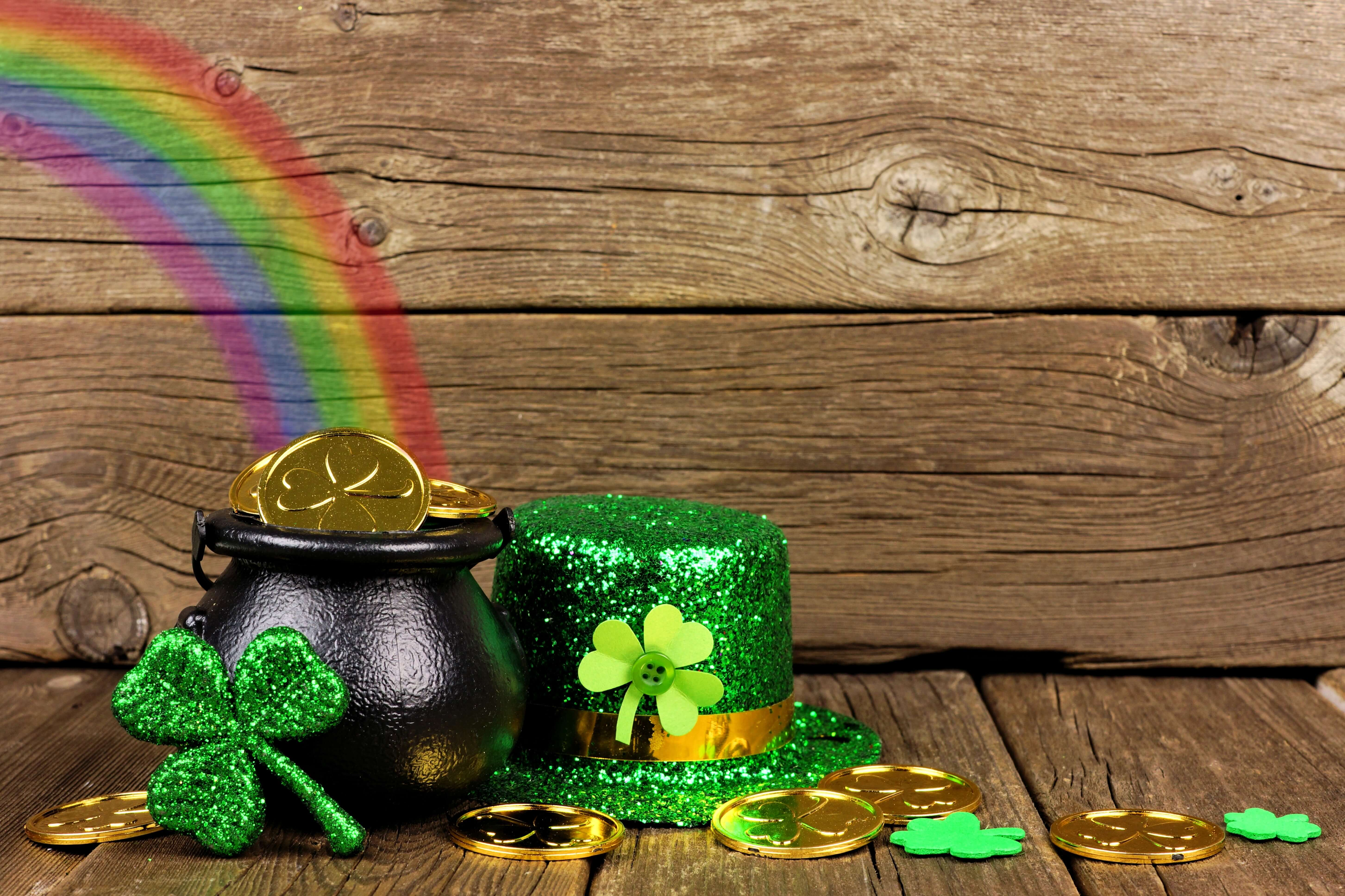 St Patricks Day Pot Of Gold With Rainbow Shamrocks And Hat Against Rustic Wood
