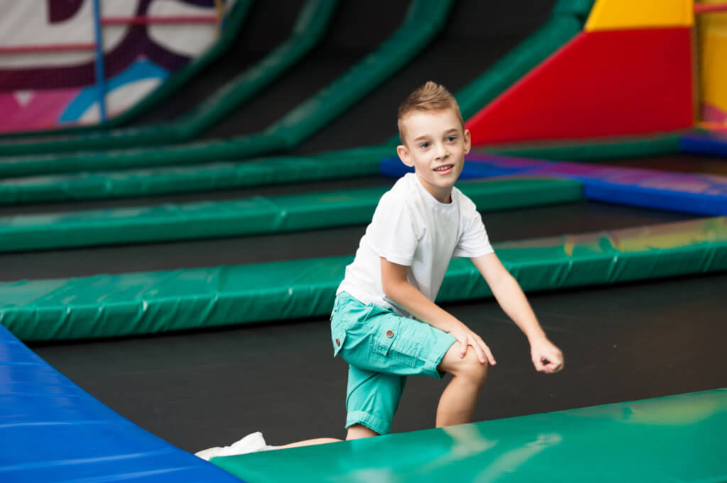 Little boy jumping on a trampoline