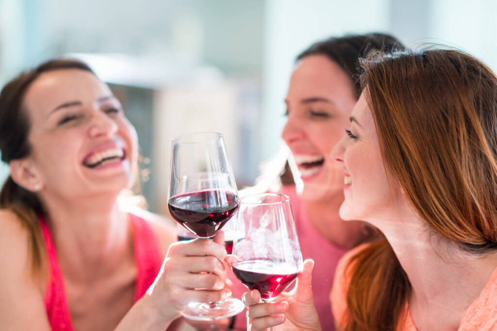 Friends drinking wine in restaurant