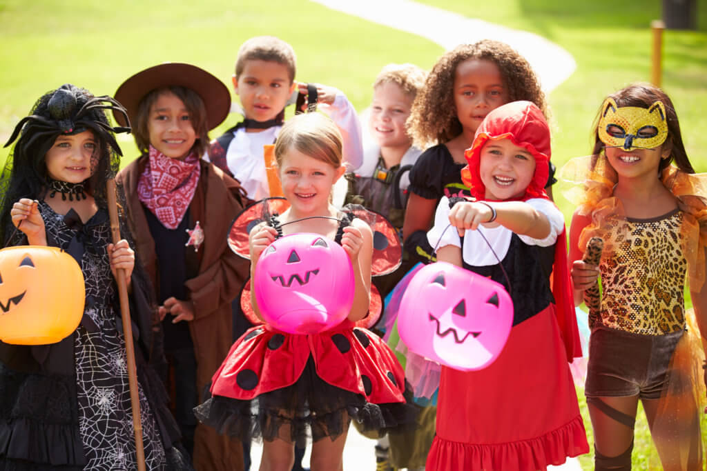 Children In Fancy Costume Dress Going Trick Or Treating