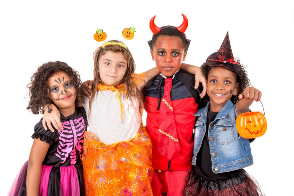 Group of kids in Halloween/Carnaval costumes isolated
